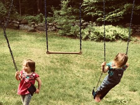 Twins on swings